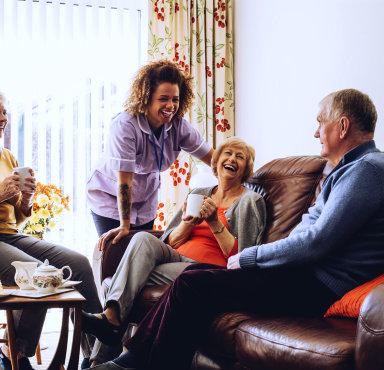 senior couple with their caregiver talking