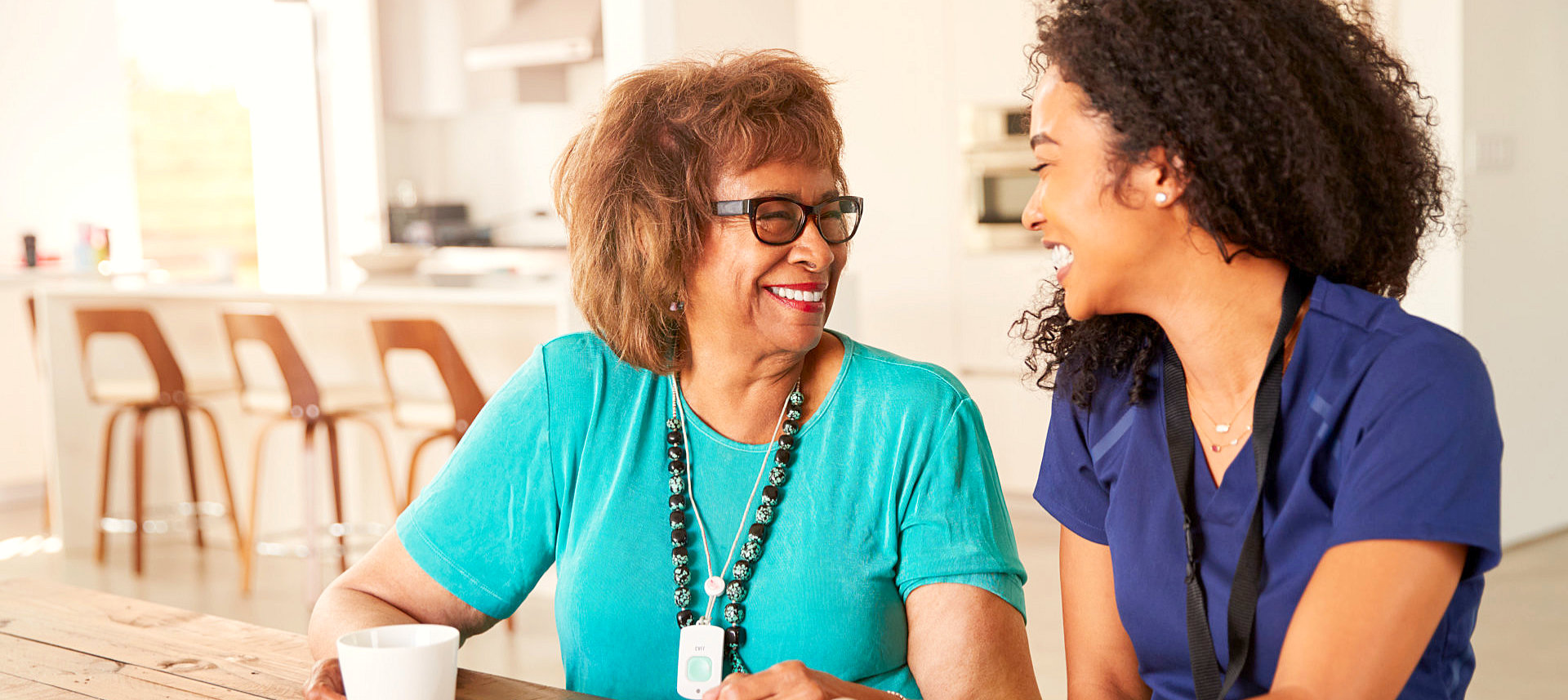 senior woman with her caregiver smiling