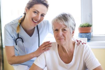 caregiver and registed nurse smiling
