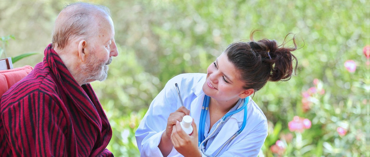 caregiver and senior man having a medication management